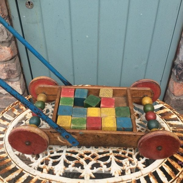 Amazing little vintage wooden push along