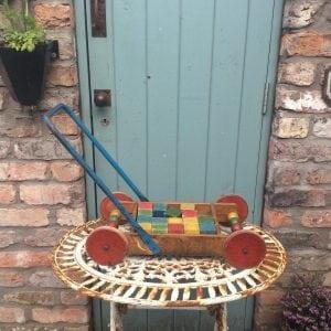 Amazing little vintage wooden push along