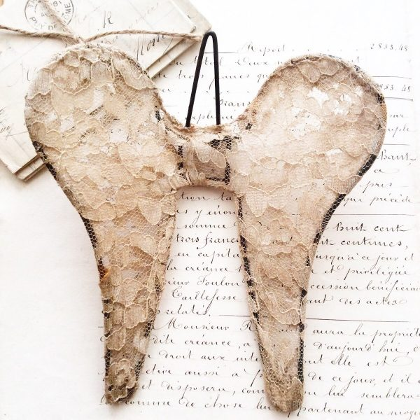 Aged lace angel wings