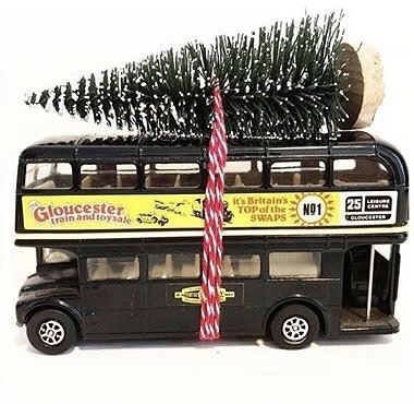 Wonderful vintage Routemaster bus with bottle brush tree