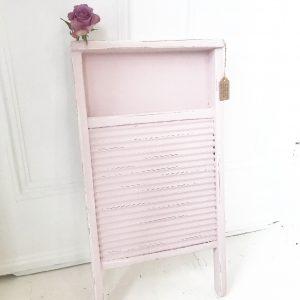 Delightful little pink vintage wooden washboard