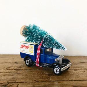Vintage Kellogg's advertising van with bottle brush tree