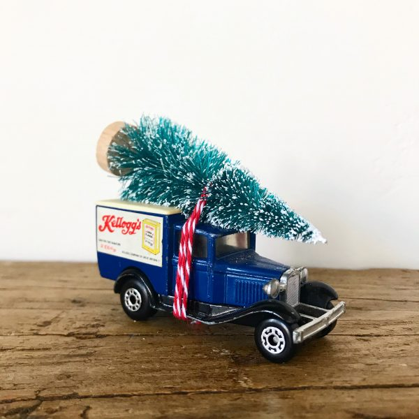 Vintage Kellogg's advertising van with bottle brush tree