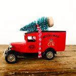 Vintage Royal Mail van with bottle brush tree
