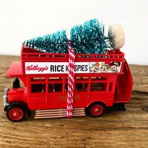 Lovely little vintage advertising bus with bottle brush tree