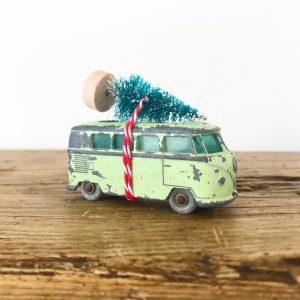 Cute little Volkswagen camper van with bottle brush tree