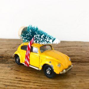 Vintage VW Beetle diecast car with bottle brush tree