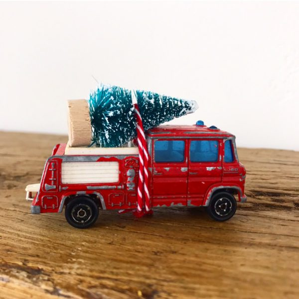 Cute little vintage fire engine with bottle brush tree