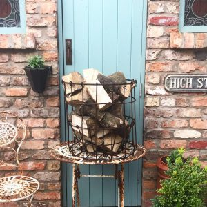 Wonderful old wrought iron log basket