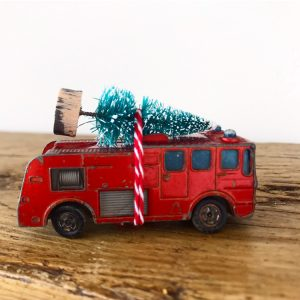 Lovely little vintage fire engine with bottle brush tree