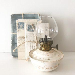Charmingly shabby vintage cream nursery oil lamp