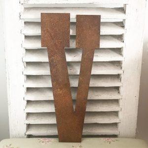 Wonderful old rusted metal shop sign letter v