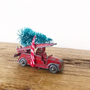 Wonderful little vintage fire engine with bottle brush tree