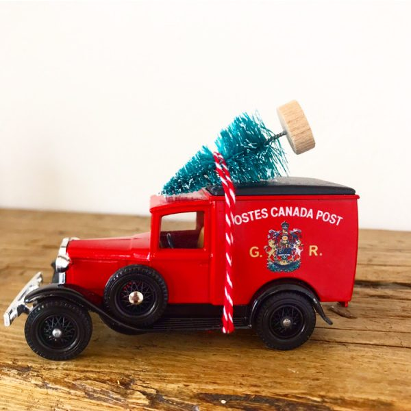 Vintage Postes Canada Post van with bottle brush tree