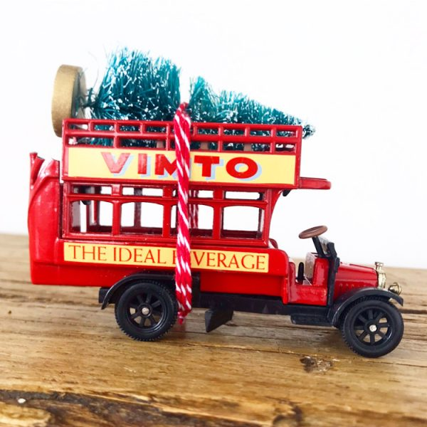 Gorgeous little vintage advertising bus with bottle brush tree