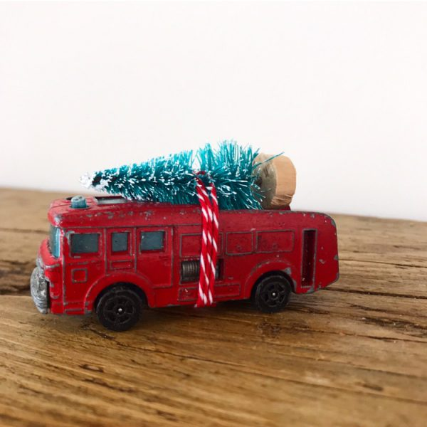 Wonderful little vintage fire engine with bottle brush tree