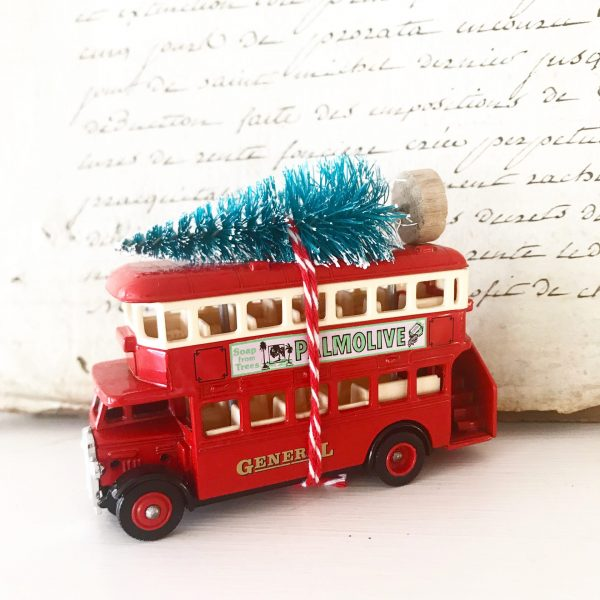 Beautiful little vintage advertising bus with bottle brush tree