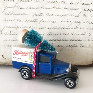 Lovely little Kelloggs van with bottle brush tree