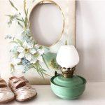 Wonderful little pale green vintage oil lamp