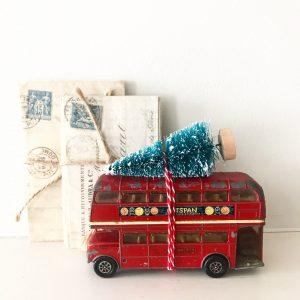 Wonderful vintage toy bus with bottle brush tree