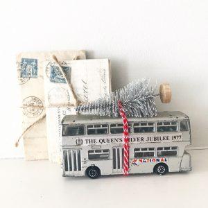 Wonderful vintage silver bus with bottle brush tree