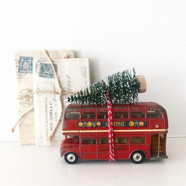 Beautiful vintage toy bus with bottle brush tree